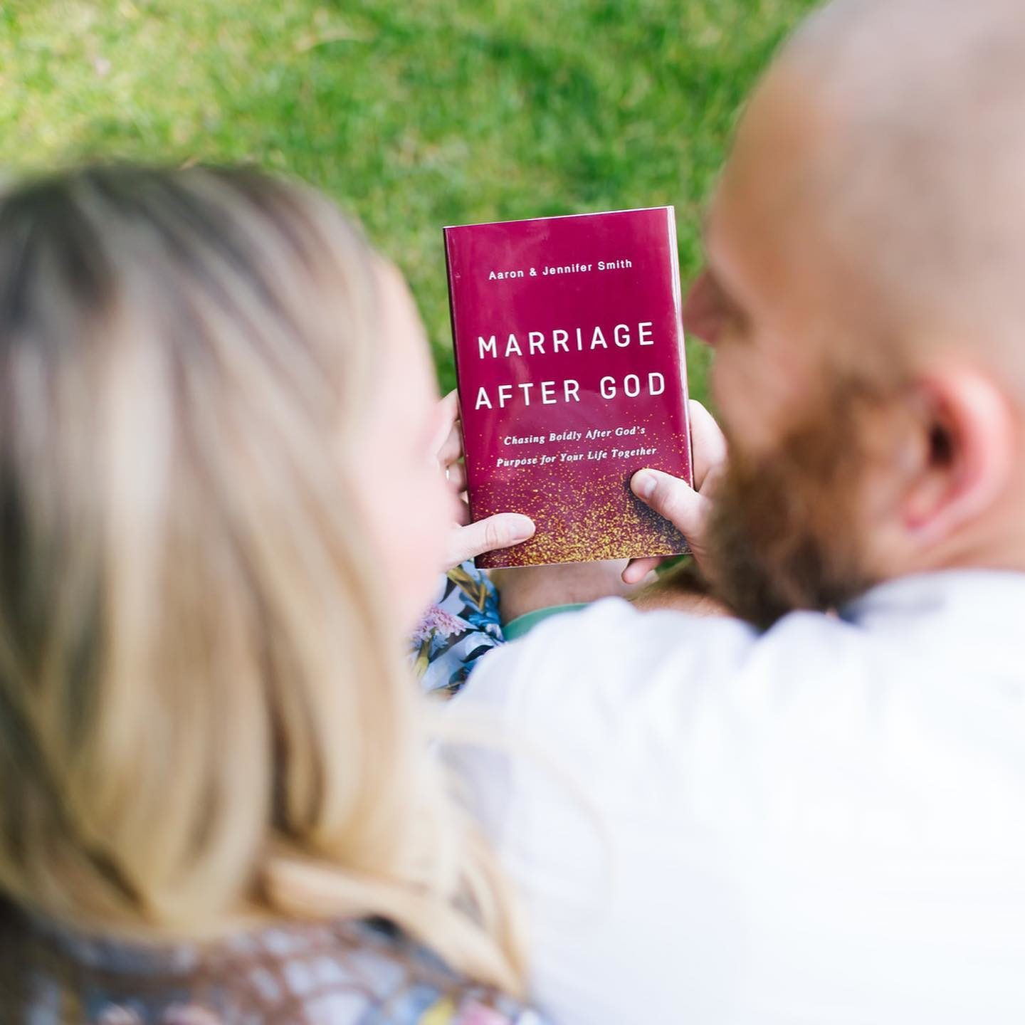 Aaron and Jennifer Smith holding their book Marriage After God.